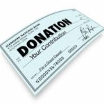Donation word on a check to illustrate a contribution or gift to SCHC