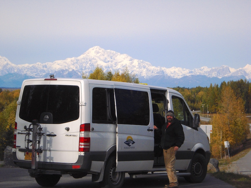 Sunshine Transit Van and driver with Denali in the background