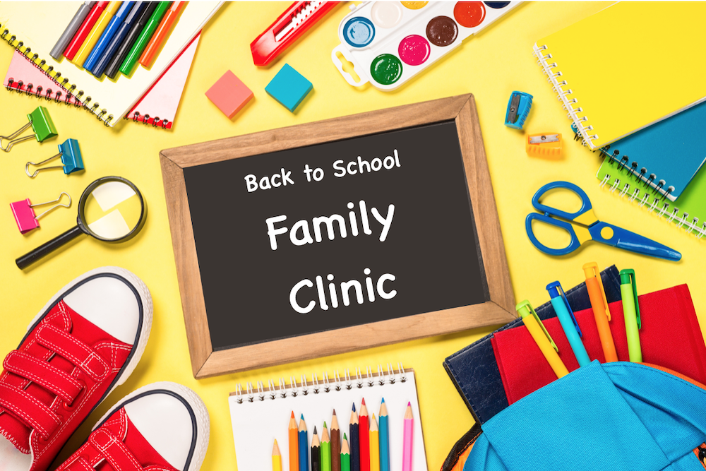 school supplies with small chalkboard that reads back to school family clinic