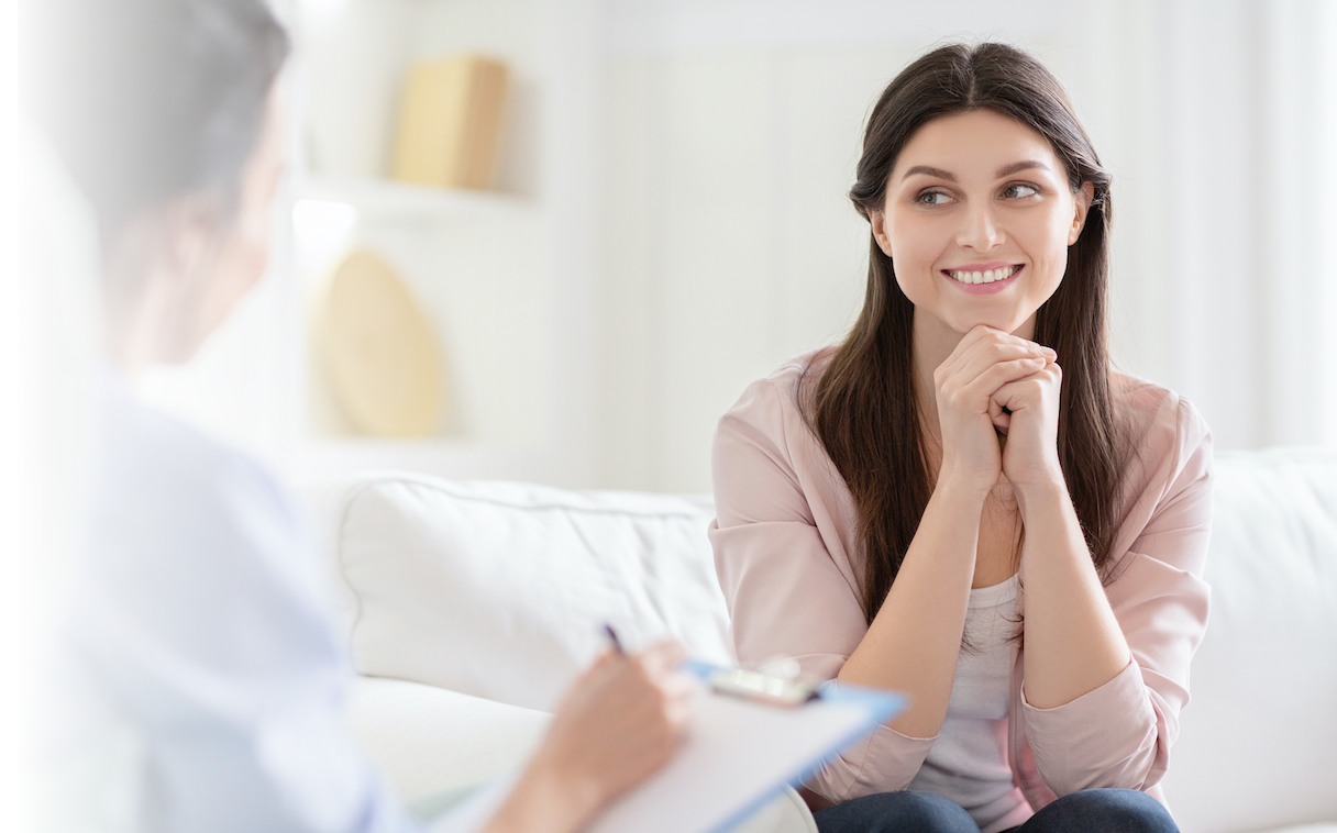 Smiling woman talking to wellness coach about motivation